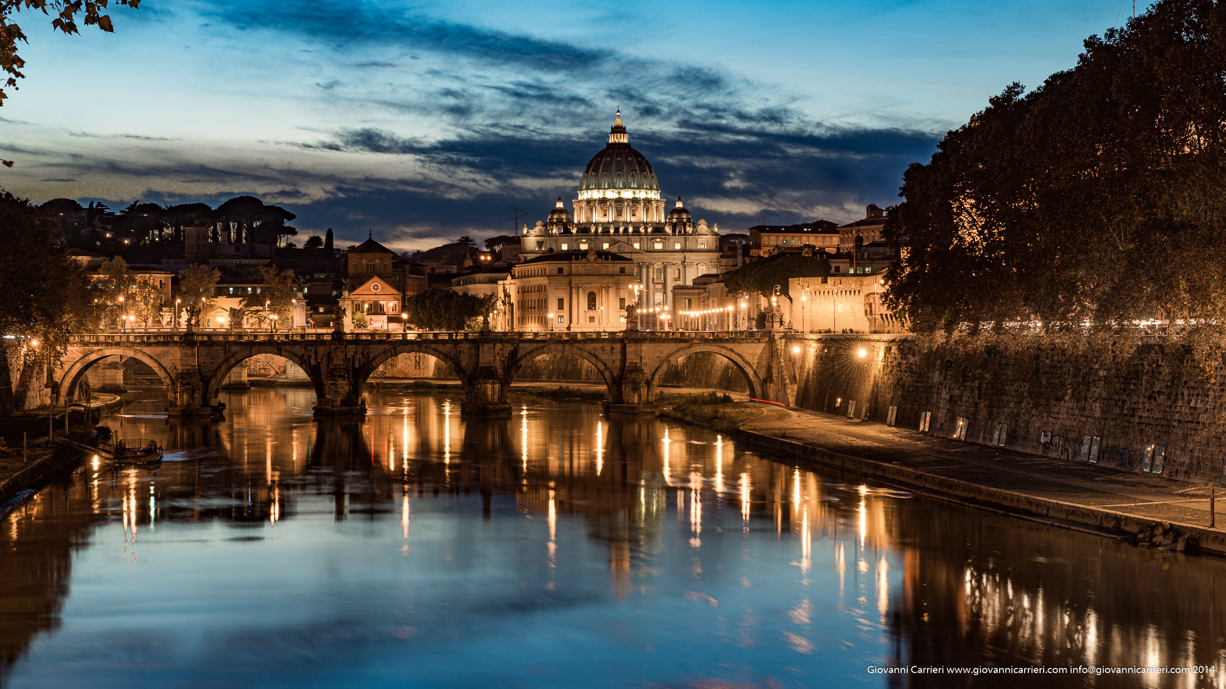 The sunset on Tevere embraces the dome of St. Peter - Rome