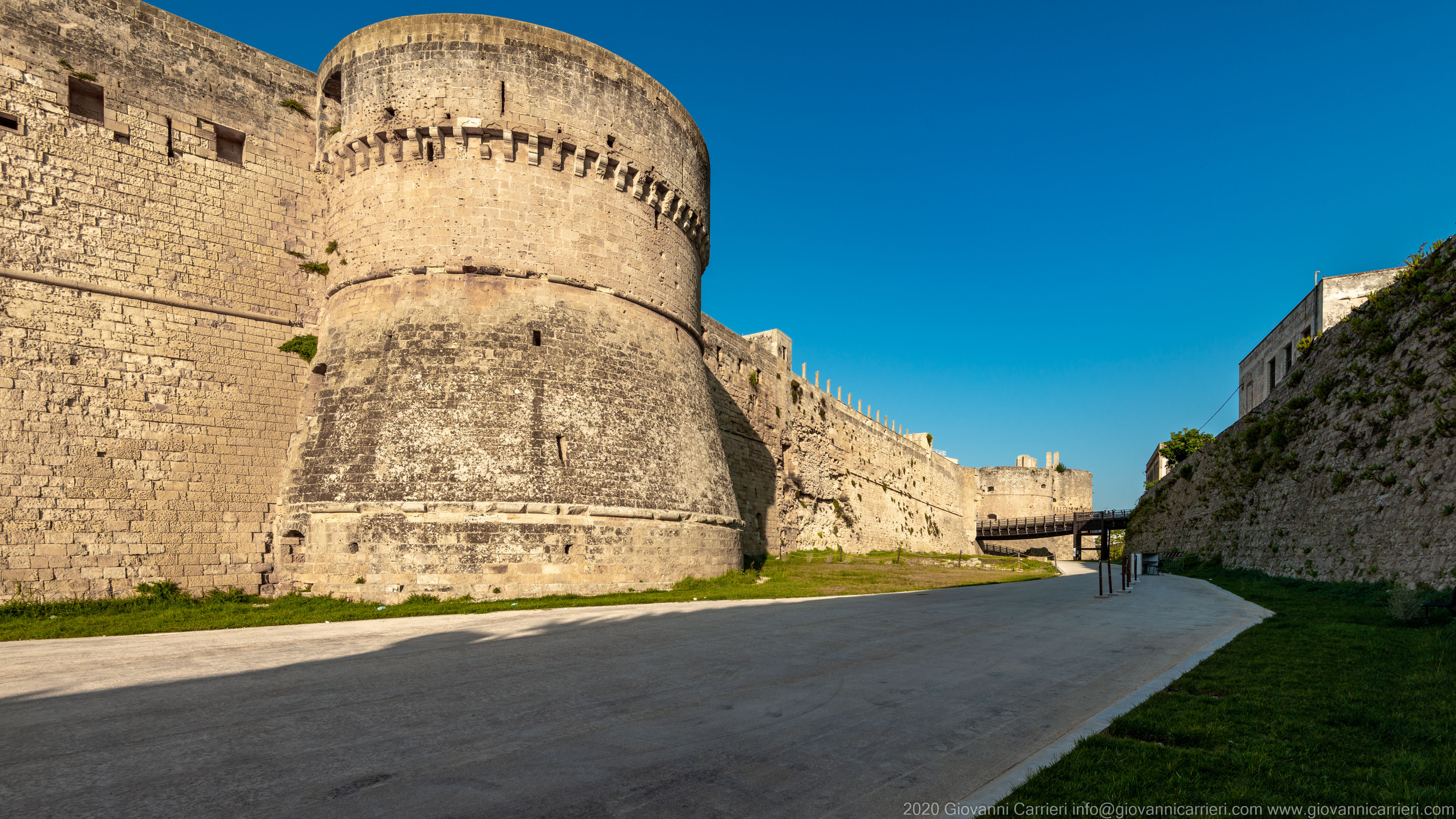 The moat of the Castle of Otranto A tower of the castle of Otranto seen from the moat