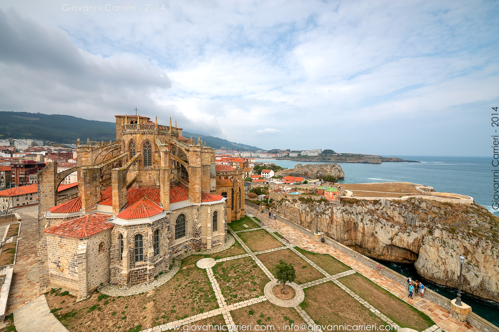 Panoramic view of the church of Santa Maria Assunta and the Bay of Biscay