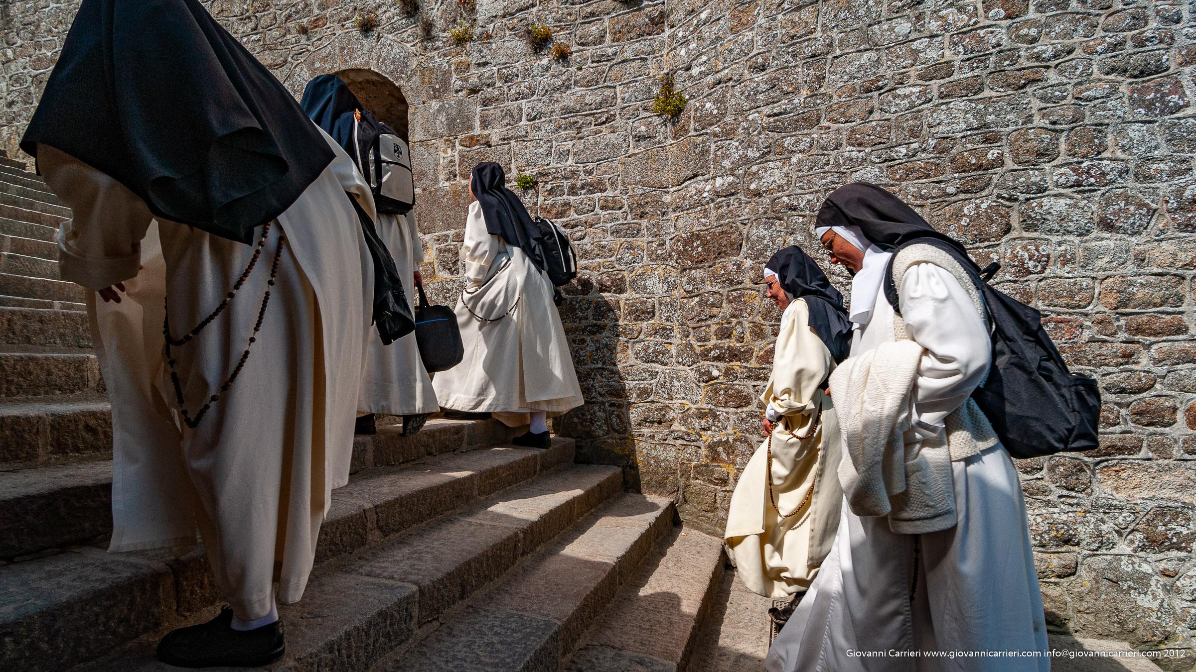 Sisters walking in Mont Saint-Michel