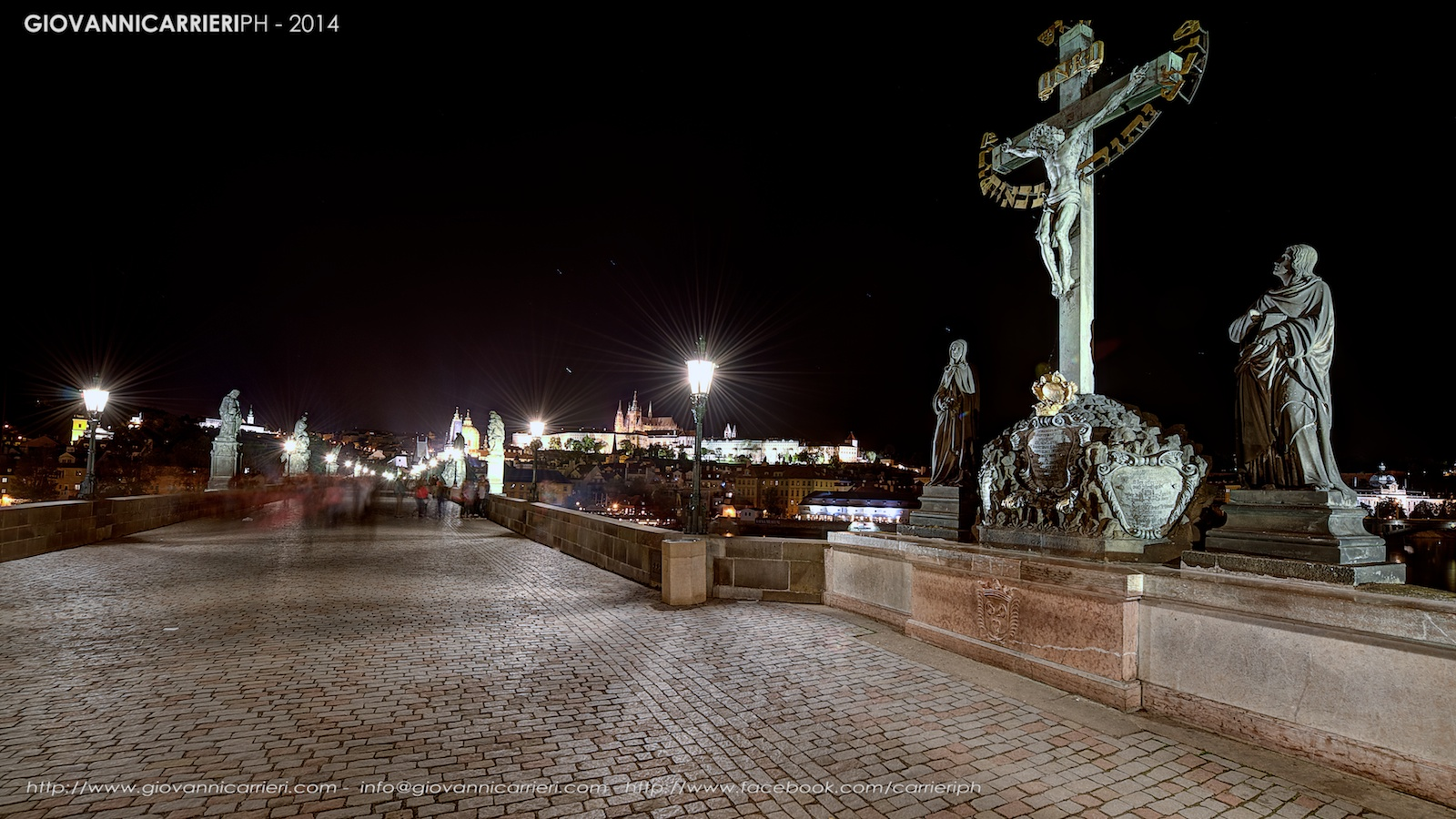 Charles Bridge and the statue of the Holy Crucifixion - Prague