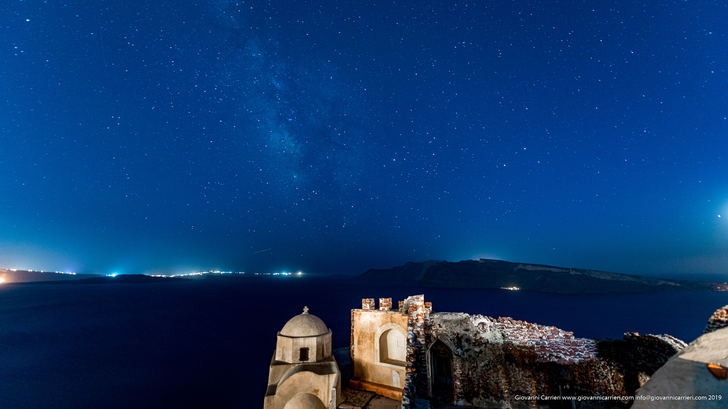 The night sky over the caldera of Santorini seen from the fortress of Oia